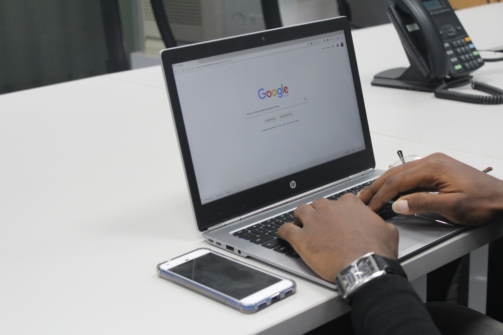 man using google on hp laptop