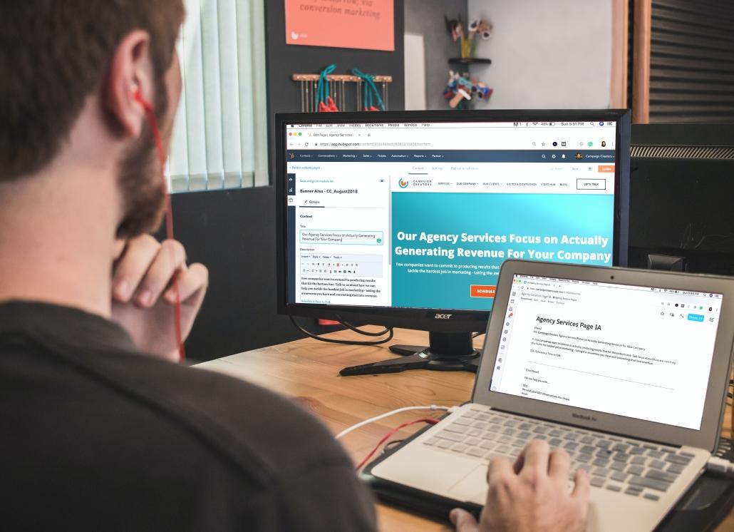 man on laptop with desktop computer