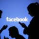 Facebook logo with silhouettes of people on phones
