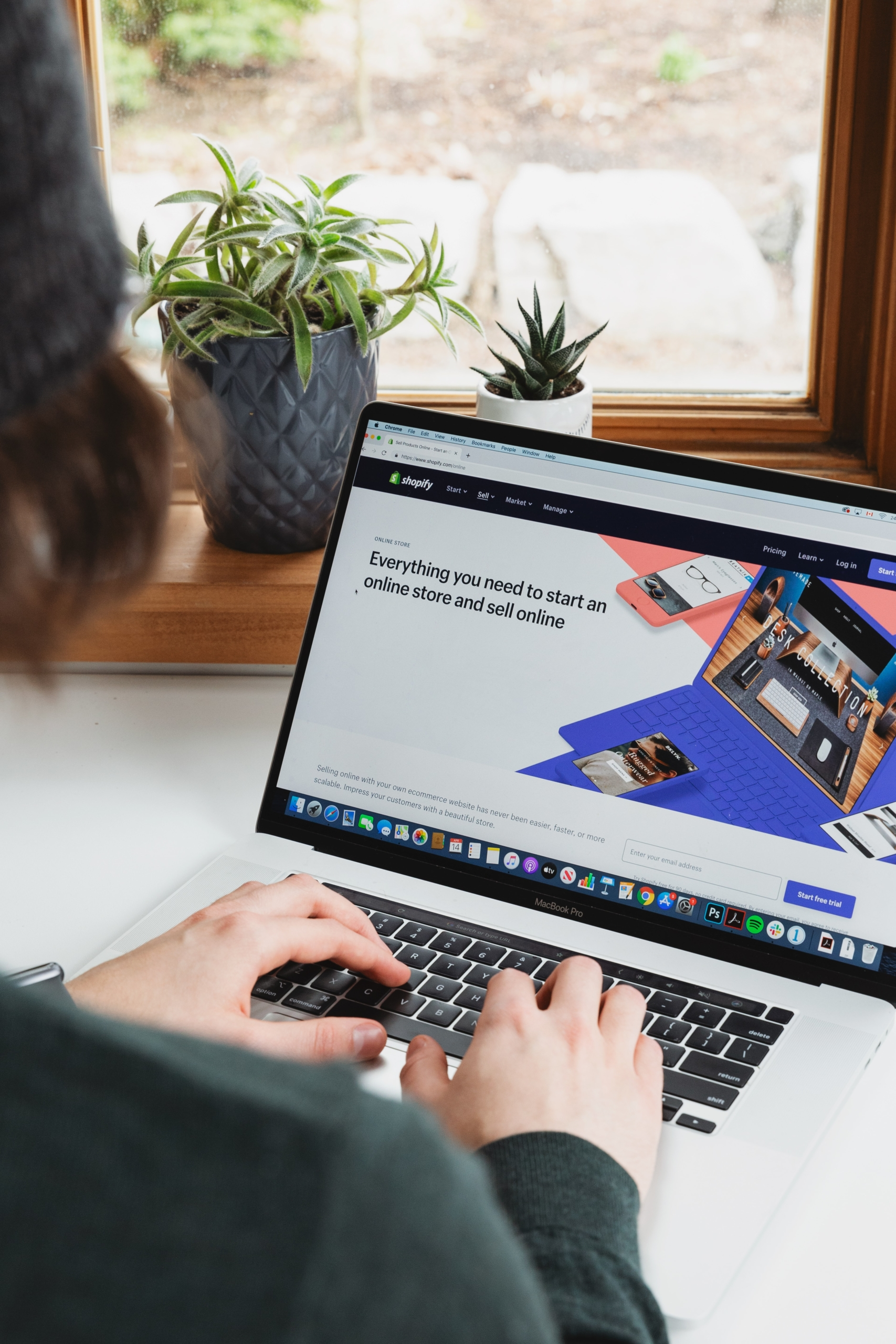 person using Shopify on laptop