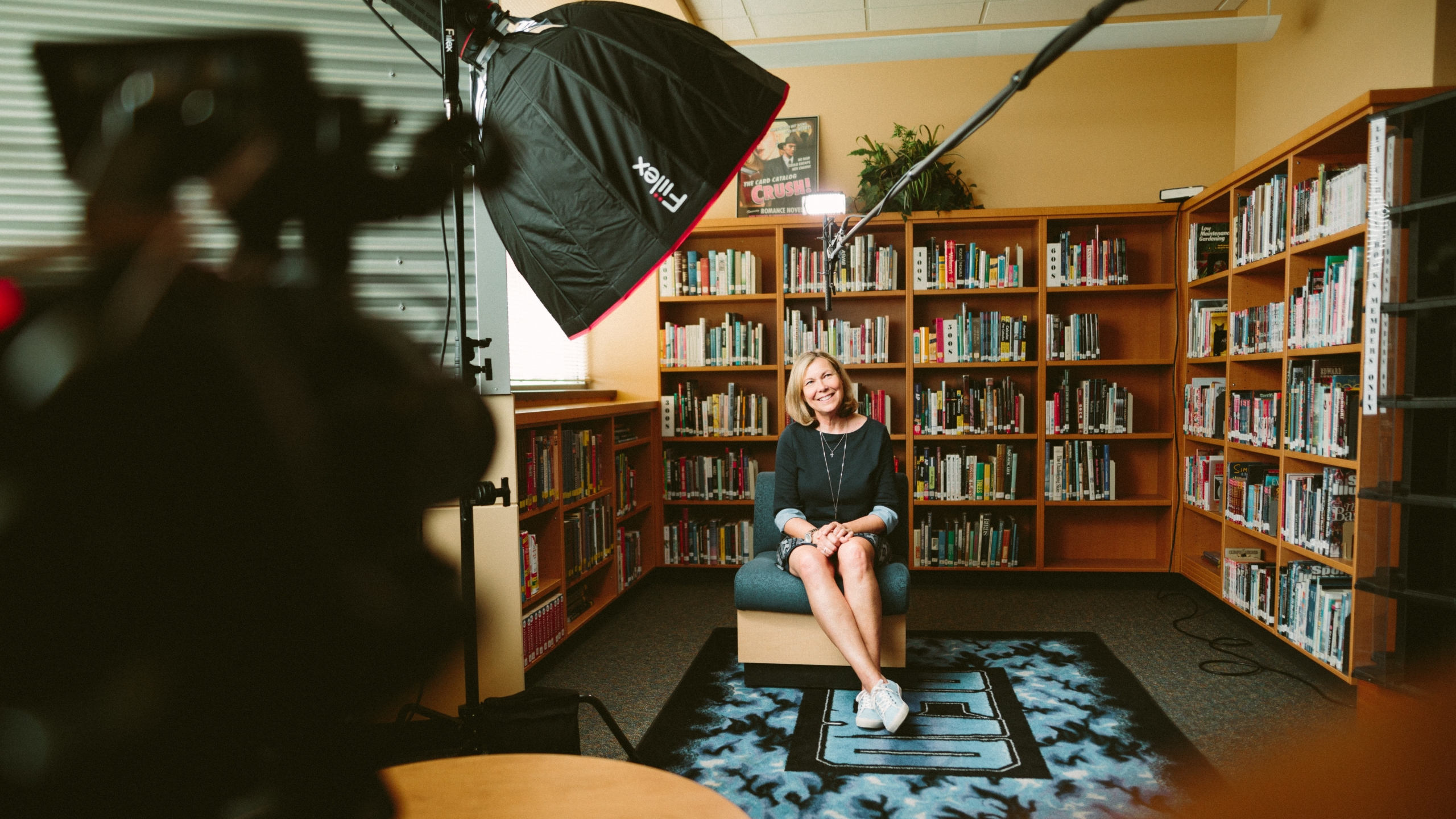 woman being interviewed in library